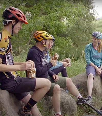 Mountain Biking Family Drinking Milk